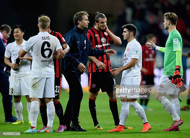 Teams shake hands after the Bundesliga match between Eintracht Frankfurt and 1 FSV Mainz 05 at CommerzbankArena on September 23 2014 in Frankfurt am...