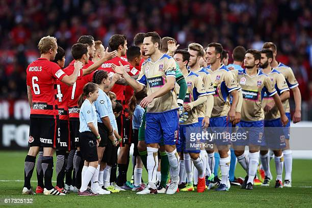 Teams shake hands prior to the round three ALeague match between the Western Sydney Wanderers and the Newcastle Jets at Spotless Stadium on October...