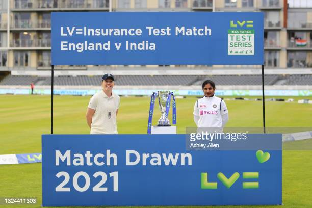 Teams share the trophy, Captain Heather Knight of England and Captain Mithali Raj of India on Day four of the LV= Insurance Test Match between...