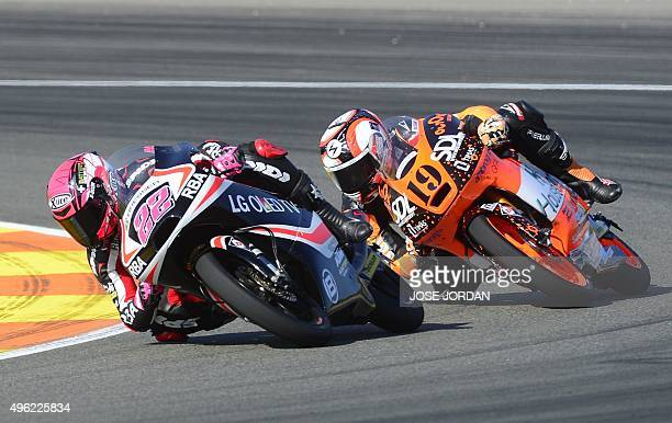 Team's Spanish rider Ana Carrasco rides ahead of Ambrogio Racing's Alessandro Tonucci during the Moto3 race at the Valencia Grand Prix at Ricardo...