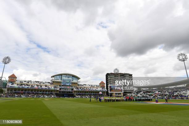 Teams stand for their national anthems ahead of the 2019 Cricket World Cup group stage match between Australia and Bangladesh at Trent Bridge in...