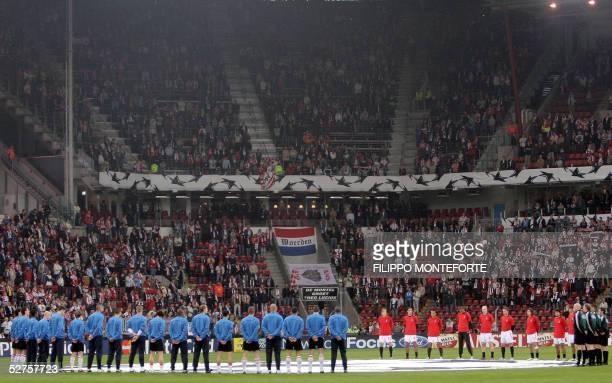 Teams stand in the middle of the pitch during a minute silence to remember national victims of WWII before the kickoff Champion's league semifinal...