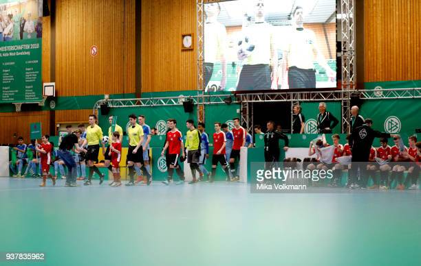 Teams walk in during the DFB Indoor Football half final match between Blumenthaler SV and VFB Eppingen on March 25 2018 in Gevelsberg Germany