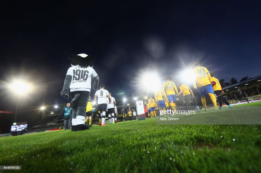 Teams walk in for the Second Bundesliga match between SV Sandhausen and Eintracht Braunschweig at Hardtwaldstadion on February 24, 2017 in Sandhausen, Germany.