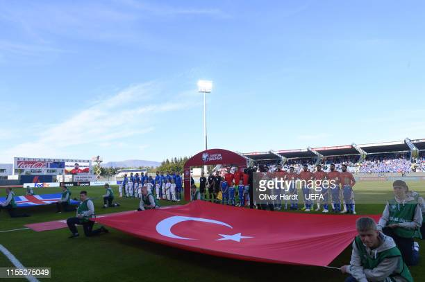 Teams walk on the pitch prior to the UEFA Euro 2020 Qualifier match between Iceland and Turkey at Laugardalsvollur National Stadium on June 11 2019...