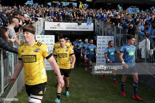 Teams walk onto the field for the round 1 Super Rugby Aotearoa match between the Blues and the Hurricanes at Eden Park on June 14, 2020 in Auckland,...