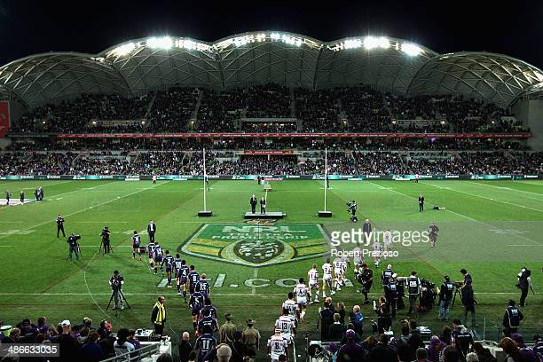 Teams walk out prior to the start of the round 8 NRL match between the Melbourne Storm and the New Zealand Warriors at AAMI Park on April 25 2014 in...