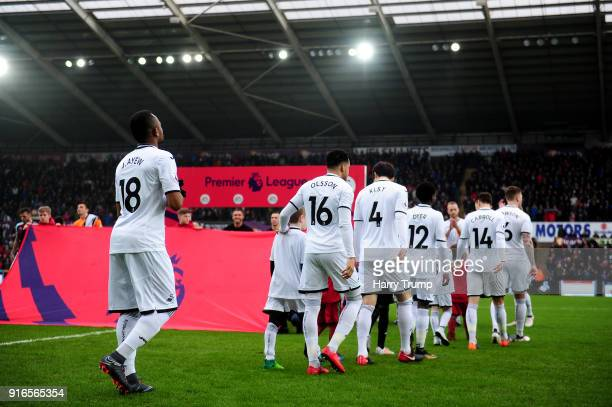 Teams walk out to the pitch ahead of the Premier League match between Swansea City and Burnley at Liberty Stadium on February 10 2018 in Swansea Wales