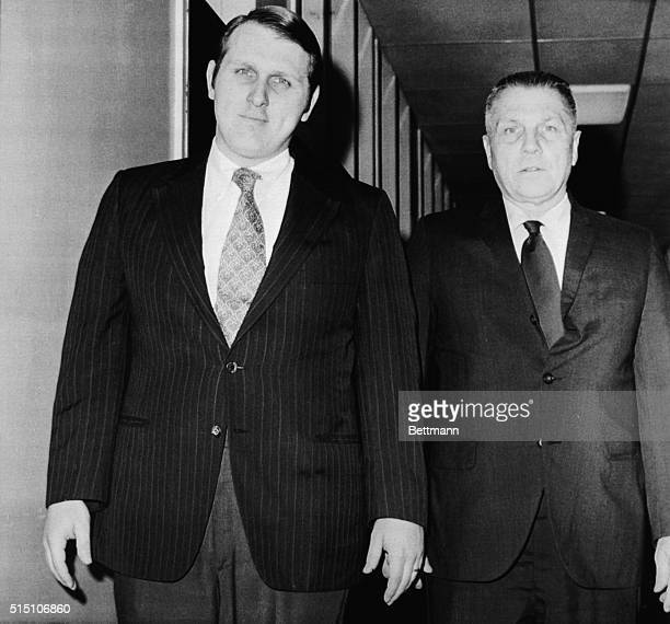 Teamster President James R Hoffa walks with son James P during hospital visit 4/9 to his seriously ill wife at University of Calif Medical Center...