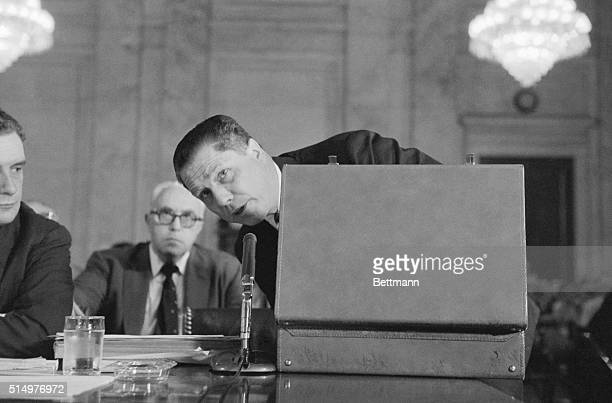 Teamster Union President James Riddle Hoffa peers from behind a briefcase while searching for records during his appearance before the Senate Labor...