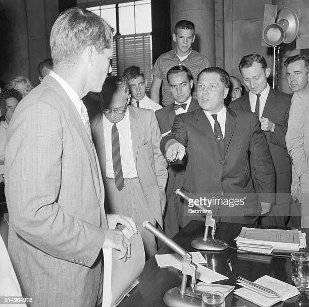 Teamsters president Jimmy Hoffa faces chief counsel Robert Kennedy at a meeting of the Senate Labor Rackets Committee.