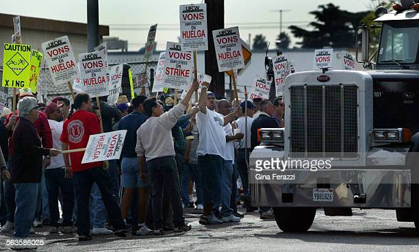 Teamsters taunt a trucker as he enters the Von's Distribution Center in El Monte Teamsters walked the picket lines Monday in solidarity of the...