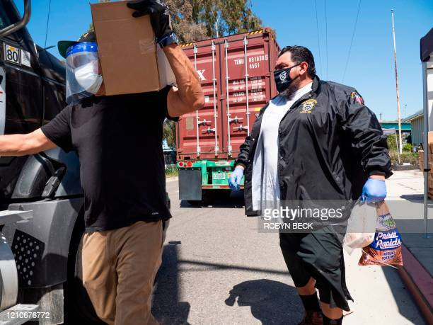 Teamsters Union members and the Los Angeles Regional Food Bank distribute food to hundreds of port truck drivers impacted by the coronavirus...