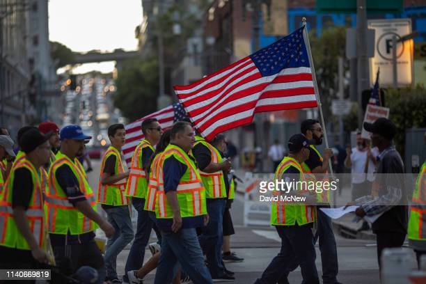 Teamsters union members march on May Day also known as International Workers Day on May 1 2019 in Los Angeles California People are participating in...