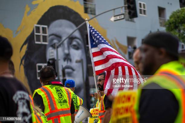 Teamsters union members march on May Day, also known as International Workers Day, on May 1, 2019 in Los Angeles, California. People are...