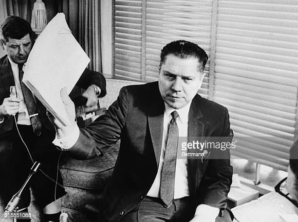 Teamsters Union President James Hoffa waves a copy of new contract at press conference after the union reached an agreement with 1000 major trucking...