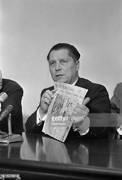 """Teamsters Union president James R. Hoffa holds newspaper bearing headline """"Hoffa Convicted on Two Counts by Federal Jury"""" which he said illustrated..."""