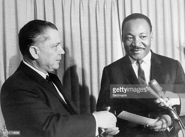 Teamsters Union President James R. Hoffa presents a $25,000 check to the Reverend Martin Luther King, Jr., to aid in his civil rights battle. The...