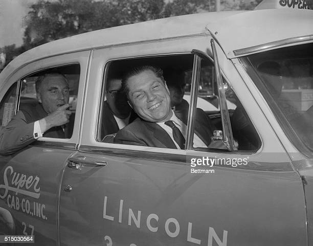 Teamsters Union Vice President James R. Hoffa flashes a winning smile as he leaves the U.S. Court after being acquitted by a federal jury of charges...