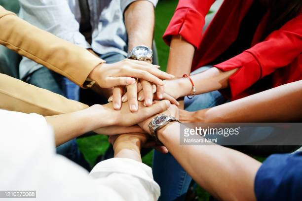 teamwork and collaboration concept. hands of successful business people or team showing the unity of power to run up the business. partnership and teamwork concept. - sharing economy stock pictures, royalty-free photos & images