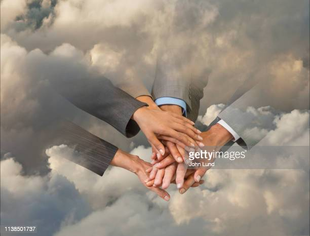 teamwork and connection in the cloud - john lund stock pictures, royalty-free photos & images