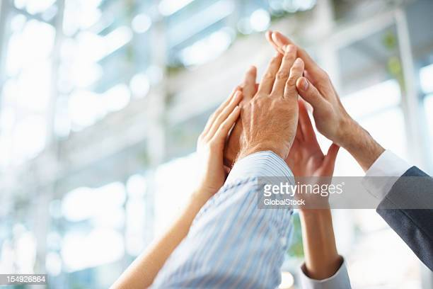 teamwork and team spirit - motivatie stockfoto's en -beelden