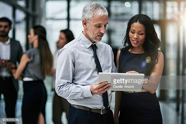 teamwork and technology, indispensable tools for corporate productivity - african american ethnicity photos stock photos and pictures