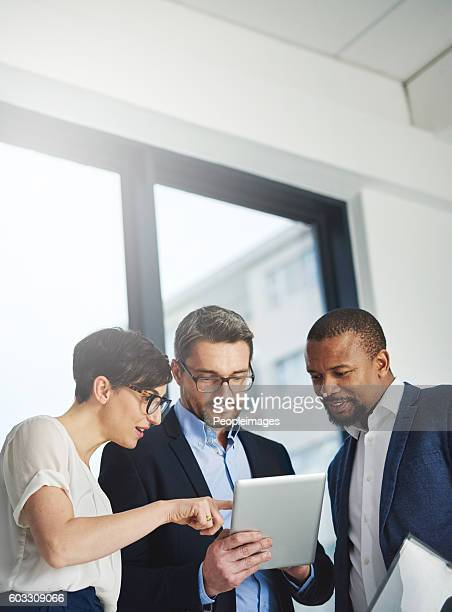 teamwork and technology - invaluable business assets - vertical stock pictures, royalty-free photos & images