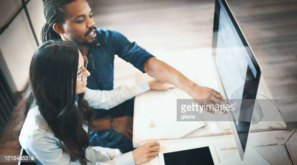 teamwork at the designer's office. - graphic designer stock pictures, royalty-free photos & images