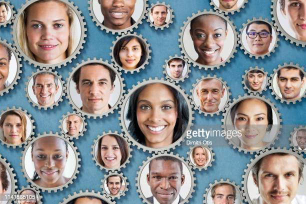 teamwork faces on interlinked cogs - organised group stock pictures, royalty-free photos & images