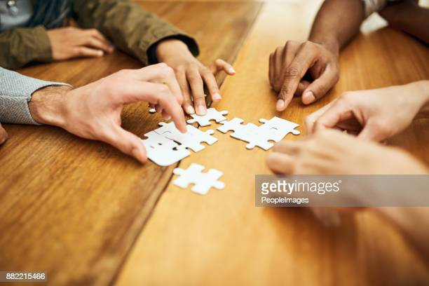 teamwork gets the job done - final game stock pictures, royalty-free photos & images
