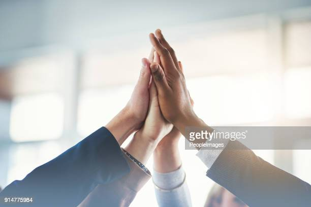 teamwork gets the job done - human limb stock pictures, royalty-free photos & images