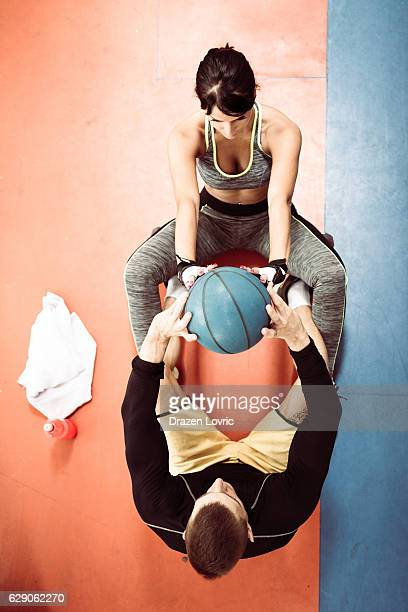 teamwork in gym, training for strong abs - circuit training stock photos and pictures