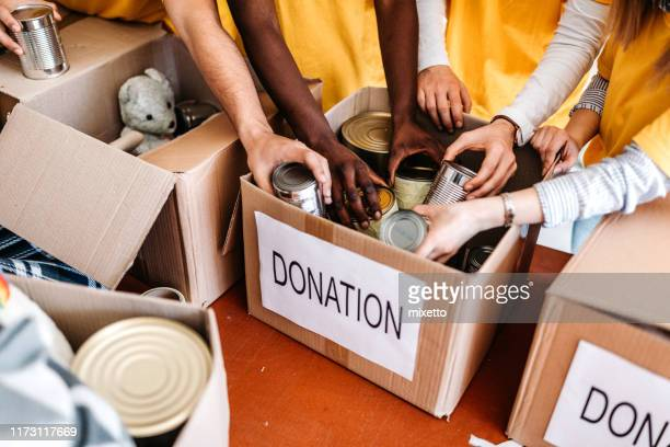 teamwork in homeless shelter - charitable donation stock pictures, royalty-free photos & images