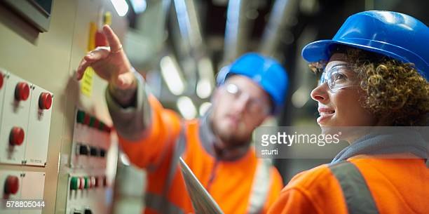 teamwork in the boiler room - energieindustrie stock-fotos und bilder