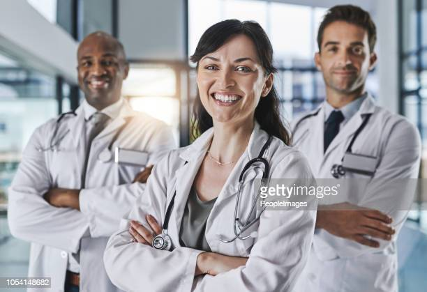 teamwork is everything in our profession - group of doctors stock pictures, royalty-free photos & images