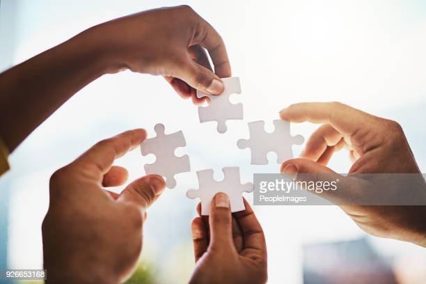 Teamarbeit macht eine Puzzle ganz