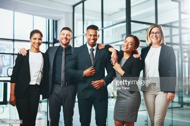 teamwork makes success happen - businesswear stock pictures, royalty-free photos & images