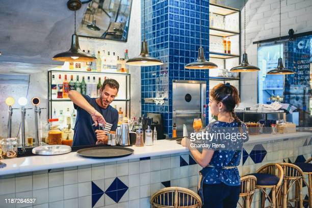 teamwork makes the bar work - franchising stock pictures, royalty-free photos & images