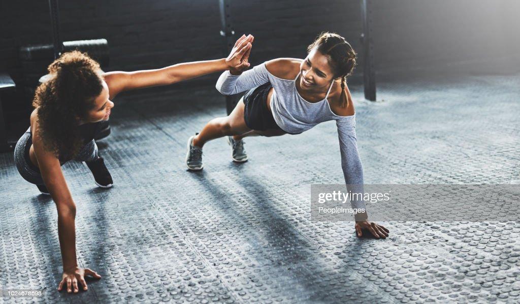 Teamwork makes the workout work : Stock Photo