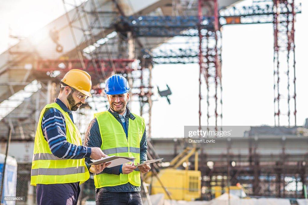 Teamwork on construction site working on bridge construction : Stock Photo