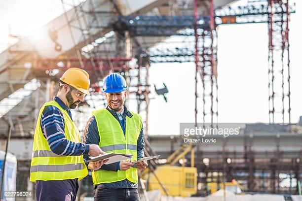 teamwork on construction site working on bridge construction - built structure stock pictures, royalty-free photos & images