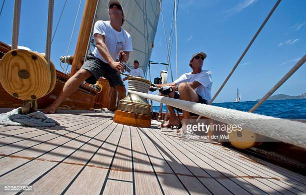 teamwork onboard classic yacht - yachting stock pictures, royalty-free photos & images