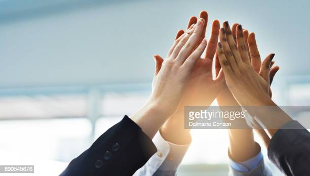 teamwork! - arms raised stock pictures, royalty-free photos & images