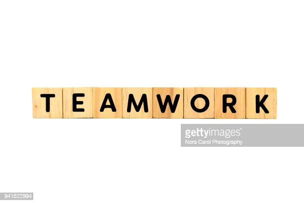 Teamwork Text on Wood Blocks on White Background
