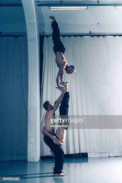 Teamwork with balance and strength performed by acrobats