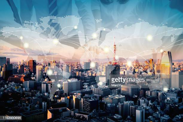 teamwork with earth map technology abstract in tokyo - global stock pictures, royalty-free photos & images