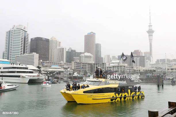 Tean New Zealand share the cup with the crowds lining the Viaduct Basin from the water during the Team New Zealand Americas Cup Welcome Home Parade...