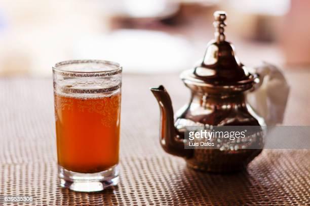Teapot and glass on mint tea