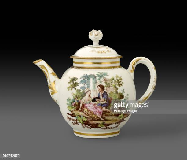 Teapot and lid 1772 Globular gilding on the plain loop handle and spoutt and a serrated gilt border round base of neck painted on one side with two...